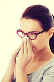 Casual beautiful woman in eyeglasses with tissue. — Stockfoto