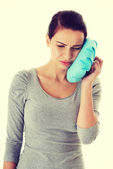 Young casual woman having a toothache. — Stock Photo