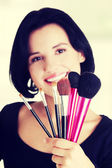 Young make-up artist — Stock Photo