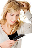 Woman loosing hair — Stock Photo