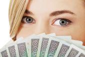 Woman with polish money — Stock Photo