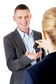 Car salesman handing over the keys — Stock Photo