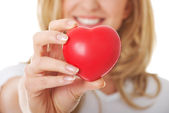 Smiling woman with red heart — Stock Photo