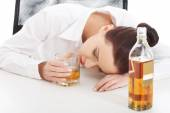 Alone young businesswoman drinking alcohol — Stock Photo