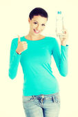 Woman with bottle of mineral water, — Stock Photo