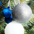 Christmas decorations- pine, balls on a tree. — Stock Photo #54253671