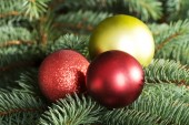 Three christmas balls hanging on a twig. — Stock Photo