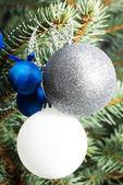 Christmas decorations- pine, balls on a tree. — Stock Photo