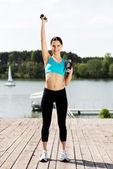 Woman exercising outdoors — Stock Photo