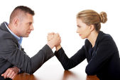 Businesspeople fighting on hands — Stock Photo