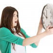 Surprised woman holding a clock — Stock Photo #57039877