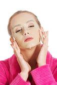 Women getting facial mask — Stock Photo