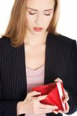 Young woman with empty wallet — Stock Photo