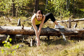 Woman stretching after running — Stock Photo