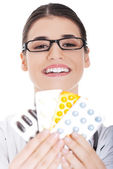 Female doctor holding pills — Stock Photo