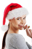 Woman with a christmas biscuit — Stock Photo