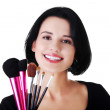 Make-up artist holding brushes — Stock Photo #57098915