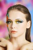 Woman with artistic make up — Stock Photo