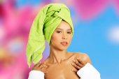 Young woman with a towel on head — Stock Photo