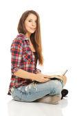 Woman sitting cross-legged — Stock Photo