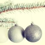Three christmas balls hanging on a twig. — Stock Photo #58545199