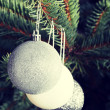 Three christmas balls hanging on a twig. — Stock Photo #58546095