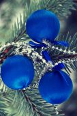 Three christmas balls on a tree. — Stock Photo