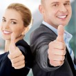 Business couple showing thumbs up — Stock Photo #58559741