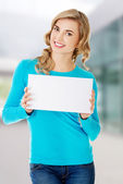 Portrait of happy woman with blank board — Stock Photo