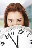 Woman holding office clock — Stock Photo