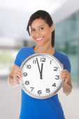 Woman holding clock — Stock Photo