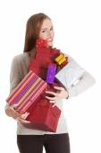 Woman holding full of presents — Stock Photo