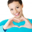 Portrait of happy woman making heart sign — Stock Photo #58580305