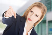 Beautiful business woman is showing warning sign. — Stock Photo