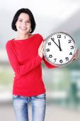 Happy young woman holding office clock — Stock Photo