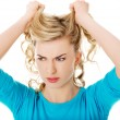 Portrait of angry woman pulling her hair — Stock Photo #58621365