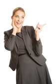Businesswoman holding hands on chin — Stock Photo