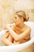Woman relaxing in a bath — Stock Photo