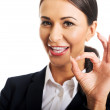 Businesswoman showing ok sign — Stock Photo #59239977