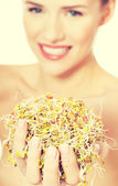 Beautiful caucasian woman with green cress. — Stock Photo