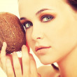 Attractive young woman with coconut. Closeup. — Stock Photo #59656109