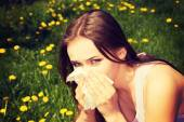 Attractive young woman outdoor with tissue. — Stock Photo