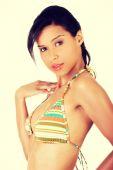 Portrait of dark skinned girl in bikini — Stock Photo