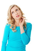 Portrait thoughtful woman scratching her neck — Stock Photo