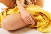 Close up on woman sitting wrapped in towel — Stock Photo