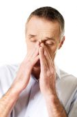 Mature man suffering from sinus pressure pain — Stockfoto