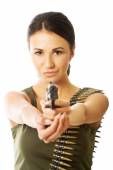 Military woman wearing bullet belt and shooting — Stock Photo