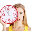 Portrait of a woman holding big clock — Stock Photo #61443081