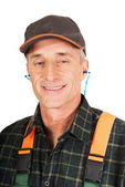 Mature worker wearing ear protectors — Stock Photo