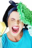 Portrait of screaming woman with a mop and sponge — Stock Photo